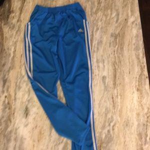 Boys Blue Adidas warm up pants.